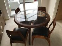 Walnut table and chairs good condition.