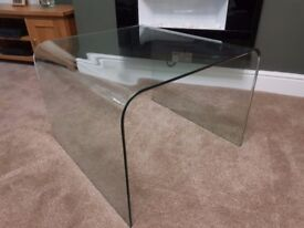 Curved clear glass coffee table