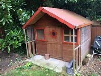Wooden chalet playhouse