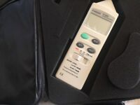 Sound level meter with shoulder case and instructions