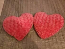 Pink furry heart cushions
