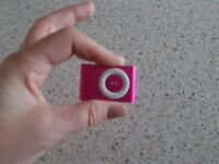 Pink Ipod Shuffle and charger