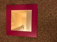 Pink wall mirror and pedestal mirror