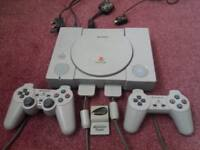 PS1 (Sony Playstation 1) console, controllers x 2, memory card and games bundle
