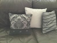 A selection of black and silver cushions