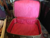 Vintage shocking pink suitcase