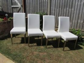4 White Faux Leather Dining Room Chairs with Chrome Legs