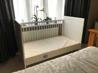 Cot bed including mattress