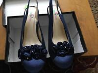 New still in box Navy blue shoe