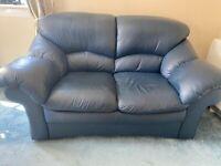 FREE 2 seater leather sofa.
