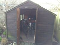 Large wooden shed is ready for collection after dismantling