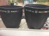 Two strong plastic pots and two Stewart drip trays