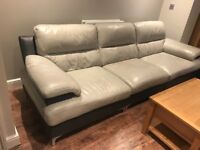 Leather sofa and footstool dfs. Grey and Graphite in colour, used condition