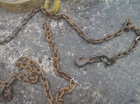 Heavy duty chain with ring, hook, shackle, attached plus sling.