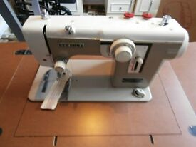 Janome (Newhome) model 676 Electric Sewing Machine and Table