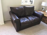 2 seater, brown leather sofa and pouf bought from House of Fraser, used but in good condition