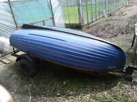 Fishing boat with trailer and outboard