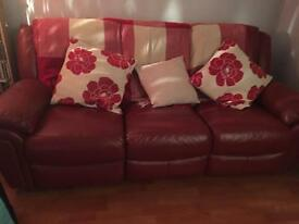 FREE 2 and 3 seater red leather settees. Recliners