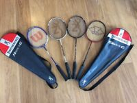 four Badminton racquets (two Browning 75g) in cases. one wilson, one carlton