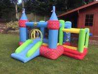 Kids bouncy castle and ball pond with slide