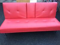 Red leather futon / sofa bed (cinema style)