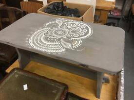 Coffee table. Molly's area.