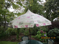 Patio table, four chairs, seat covers and parasol