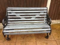 Cast iron and wood slat garden bench in good condition buyer to collect