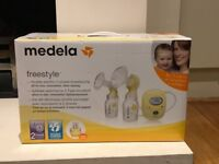 Medela Swing double breast pump with bustier and Medela easy carry bag
