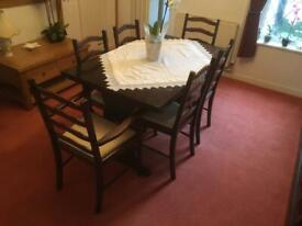 Dark oak dining table with chairs.