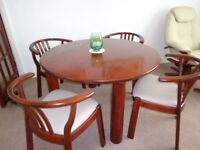 Solid wood dining table with 4 chairs, mahogany with cream upholstery. 1.2m dia. Excellent condition