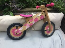 Pink Tidlo wooden balance bike