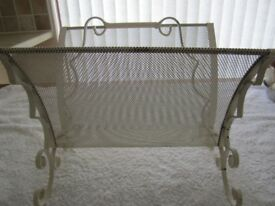 Vintage wrought iron magazine rack in used condition. Length 13.5 inches Width 10.5 inches Height
