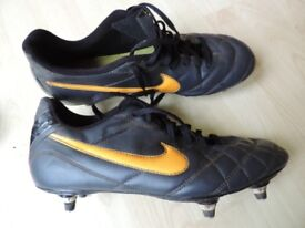 Nike Football boots Size 8 Black with orange Nike symbol. Good condition.