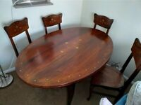Beautiful rose wood dining table and 6 chairs excellent condition
