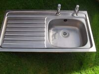 KITCHEN SINK WITH HOT AND COLD LEVER TAPS