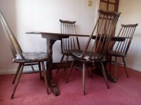 Ercol dining table and 4 chairs. Walnut - superb condition.