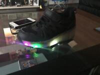 Black light up heelys
