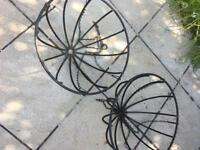 Two wrought iron hanging baskets
