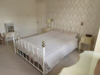 Kingsize bed frame, cream with brass knobs, very good condition as hardly used