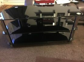Large tinted glass TVs stand