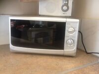 Practically brand new microwave. Brought in March but only used x2. Clean with all components.