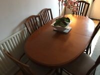 Large extending table and 8 chairs