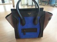 Black, beige, blue leather bag
