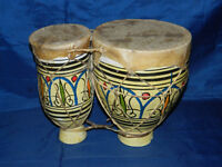 Pair of Turkish quality bongo drums with ornamental design. Some minor damage to smaller drum
