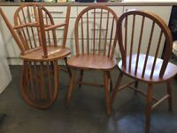 4 Wooden dining chairs - solid and in great condition