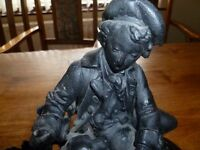 Spelter figure of man and dog 30 cms