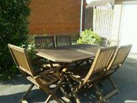 6 Seater hardwood table and 6 chairs