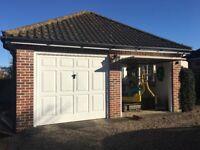 Roof tiles, ele garage door, windows, doors, guttering