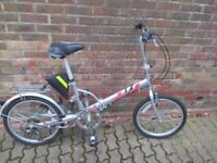 Folding Bike - as new - only ridden for 25 miles. Comes with shouder carry bag.